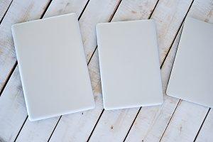White mac books on the wooden floor