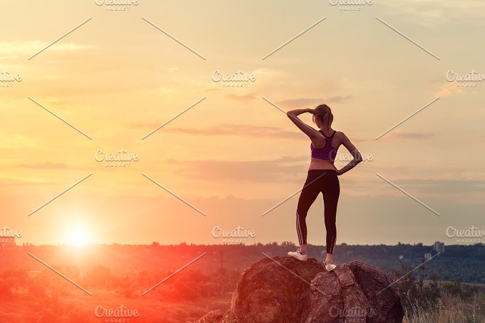 Silhouette of a sporty girl. Sunset - People