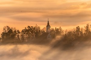 Church and villages hiding in mist