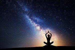 Milky Way. Woman practicing yoga