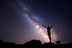 Milky Way. Silhouette of a girl