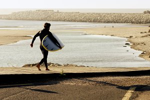 body surfer man in footpath