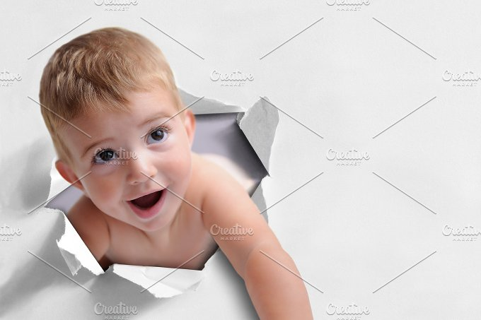 Funny background of a baby coming out of a paper.jpg - People