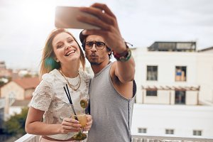 Friends taking a selfie on rooftop
