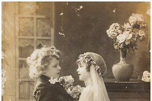 Vintage photo  of cute children in wedding dress