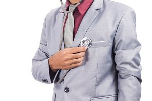 Man using stethoscope checking his heart.jpg