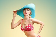 Beautiful woman in red polka dots fashionable swimsuit. PinUp