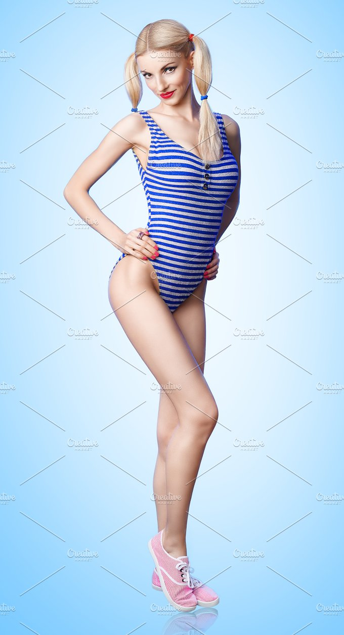 Beautiful woman in fashionable swimsuit. Pinup sexy blonde girl - Beauty & Fashion