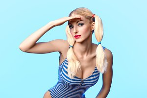 Beautiful woman in fashionable swimsuit. Pinup sexy blonde girl
