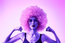 Beauty fashion. Fitness woman athletic body, unusual, afro