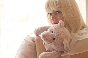 Blonde girl with teddy bear