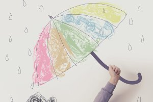 Child with colorful umbrella in the