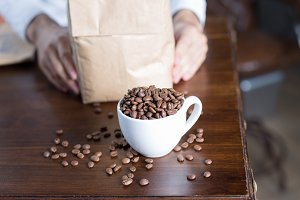 Close-up of cup with coffee beans