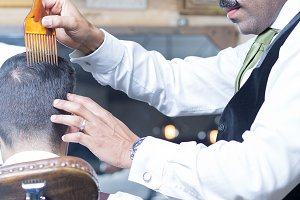 Barber with mustache combing