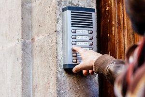 Man ringing the doorbell