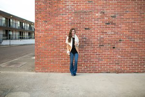 Woman Against Brick Wall
