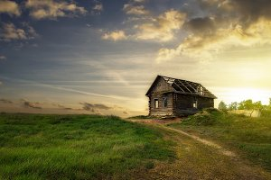 Old abandoned house in the meadow.