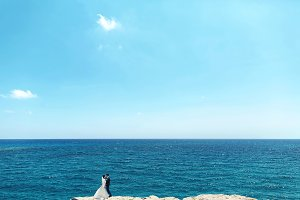 Newlyweds near the ocean