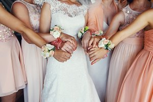 Happy bride with bridesmaids