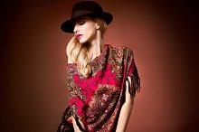 Fashion beauty woman in stylish hat shawl, autumn