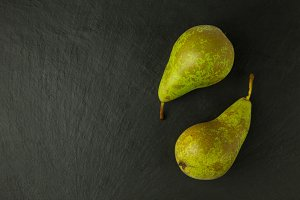Pear fruits on slate background