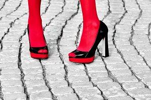 Fashion urban womens legs, heels. Black white, red