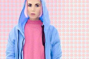 Girl in a blue coat fashion. Vanilla