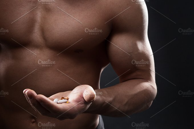 Tablets in the hand of an athlete - Sports
