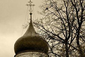 Orthodox cross on a gray sky.