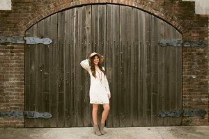 Brunette Against Big Wood Door