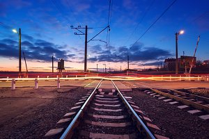 Railroad crossing at night