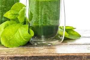 Spinach leaves smoothie in glass