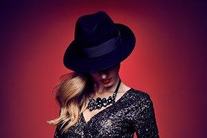 Fashion portrait woman,sequins dress black hat red