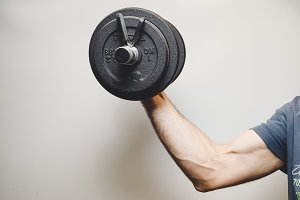 Male arm lifting weight