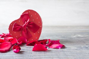 Gift box with heart shape and petals