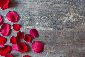 Red petals on wood