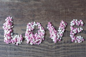 Word love with candy hearts