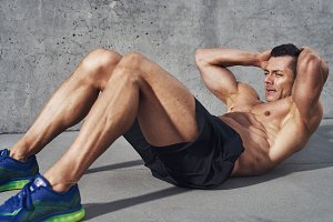 Fit male doing sit ups