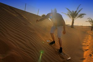 Sandboarding in the desert