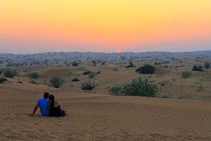 Couple and sunset in the desert