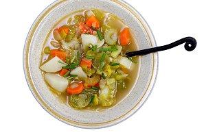 Leek soup with potato on white backg
