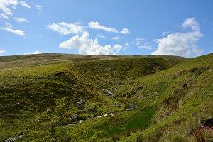 Stream through a shallow valley