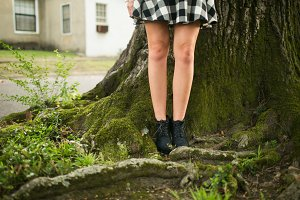 Woman's Legs Next to Tree