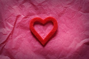 Red heart on pink paper
