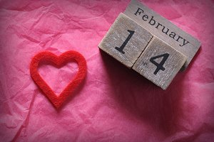 Wooden calendar with February 14th