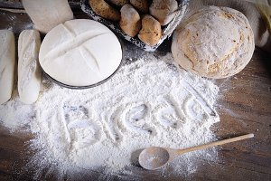 Word 'bread' written on flour