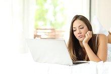 Girl bored browsing media in a laptop.jpg