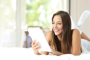 Girl reading an ebook on the bed.jpg
