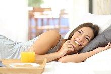 Happy girl eating dietetic cookies at breakfast.jpg