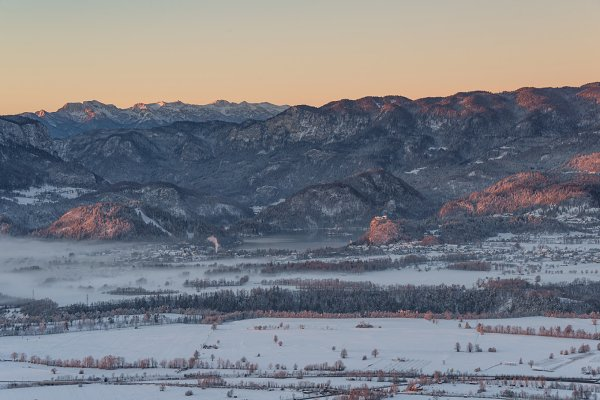Sunrise over valley with mountains